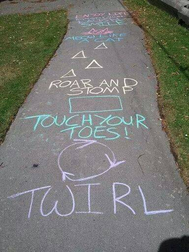 Activities drawn with chalk on pavement