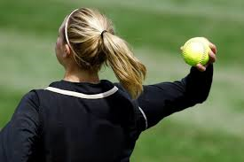 Pupil throwing ball over head